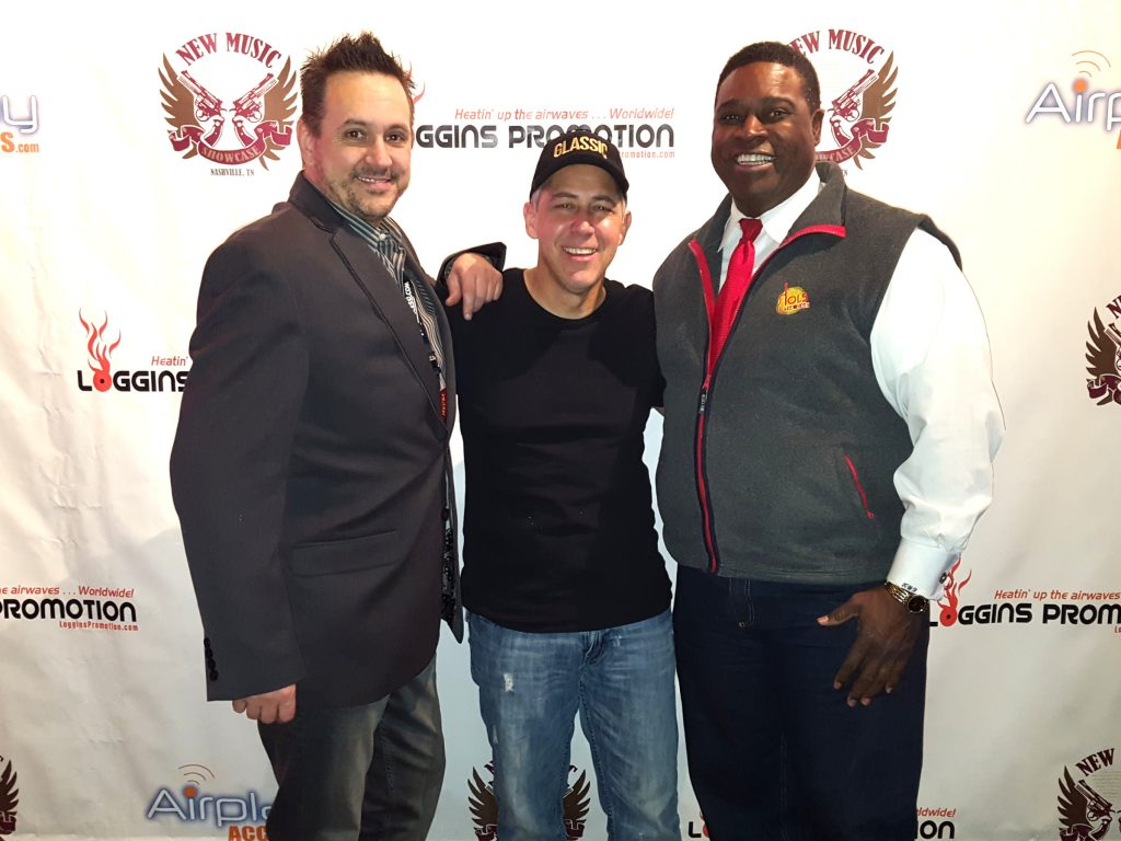 with my promoter Paul Loggins and WDKN radio owner Kenneth Forte